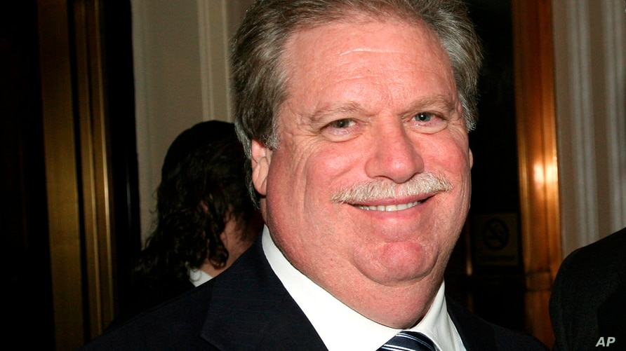FILE - In this Feb. 27, 2008, file photo, Elliott Broidy poses for a photo at an event in New York. Federal prosecutors have…