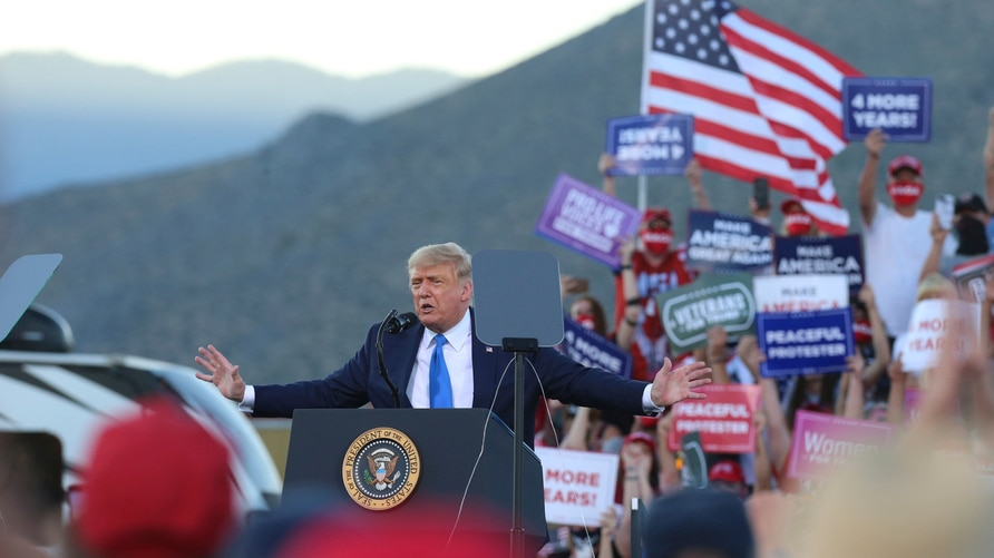 President Donald Trump speaks at a campaign rally at Carson City Airport, Sunday, Oct. 18, 2020, in Carson City, Nev. (AP Photo…