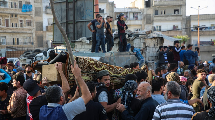 People attend funeral of fighters killed in an airstrike in the town of Idlib, Syria, Monday, Oct. 26, 2020. An airstrike on a…