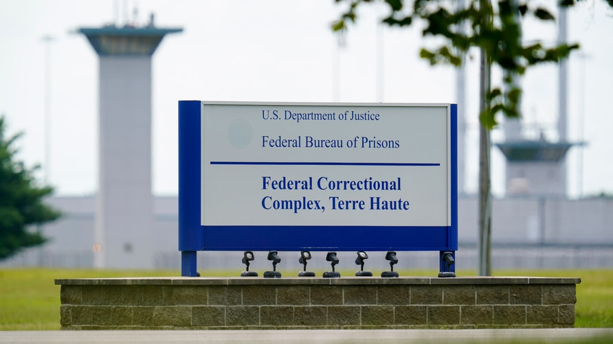 FILE - In this Aug. 28, 2020, file photo shows the federal prison complex in Terre Haute, Ind. A wave of federal executions by…