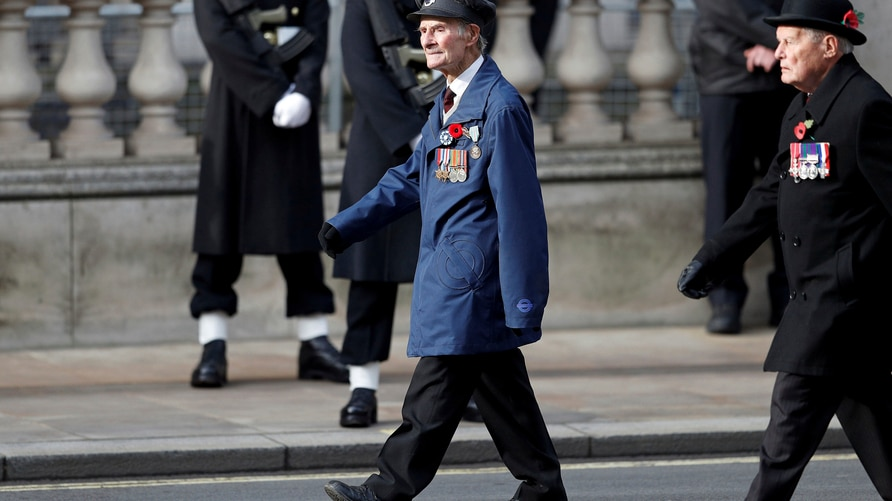 D-Day veteran John Aichison, 96, centre, attends the Remembrance Sunday service at the Cenotaph, in Whitehall, London, Sunday…