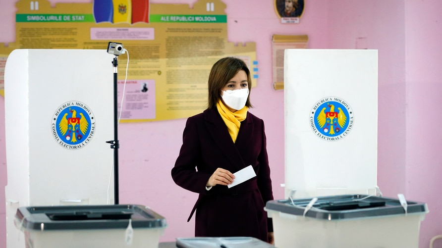 Former prime minister Maia Sandu prepares to cast her vote in the country's presidential election runoff in Chisinau, Moldova,…