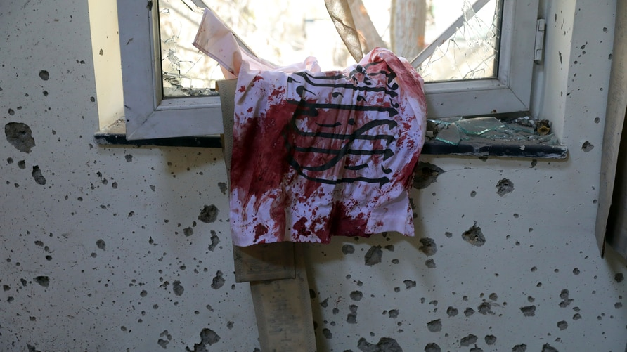 A blood-stained Taliban flag is seen on the window inside the Kabul University after a deadly attack in Kabul, Afghanistan,…