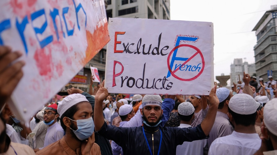 Bangladeshi Muslims protesting the French president's support of secular laws allowing caricatures of the Prophet Muhammad…