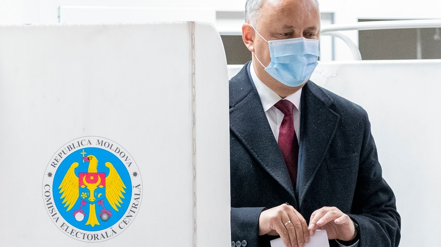 Incumbent Moldovan President Igor Dodon prepares to cast his vote in the country's presidential elections in Chisinau, Moldova,…