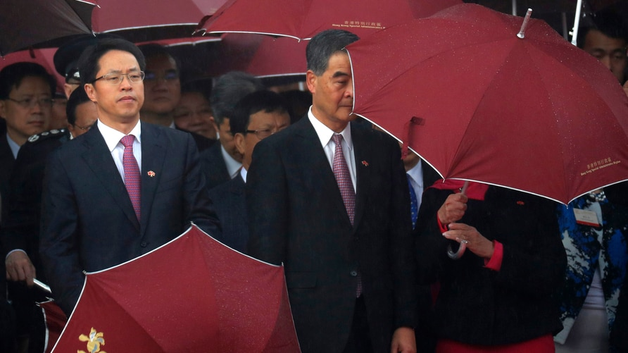 Hong Kong Chief Executive Leung Chun-ying,  center, and Zhang Xiaoming, left, director of the Liaison Office of the Central…