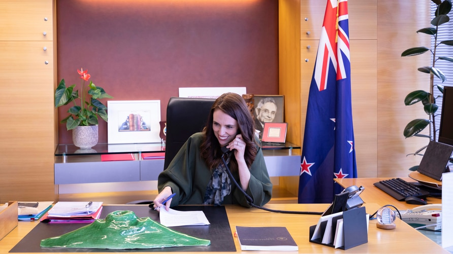In this photo provided by New Zealand Prime Minister's Office, Prime Minister Jacinda Ardern talks with U.S. President-elect…
