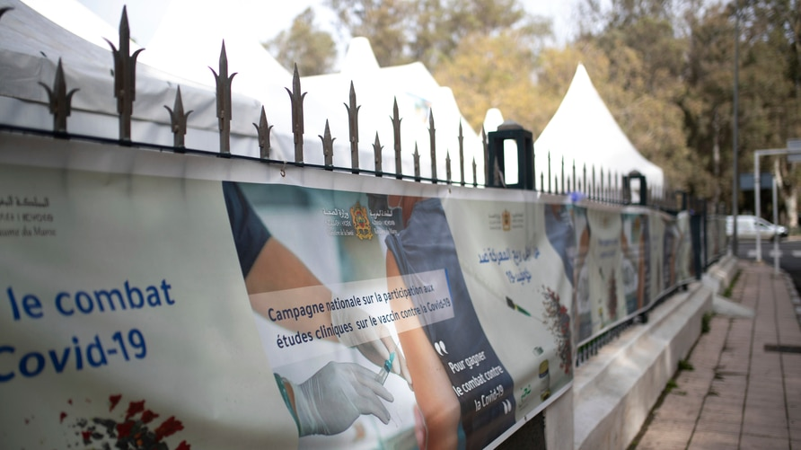 Banners are displayed outside a bivouac where clinical trials for covid-19 vaccines are conducted, in Rabat, Morocco, Monday,…