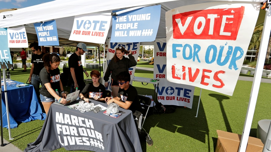FILE - In this Oct. 31, 2018 file photo, student volunteers help out at a booth to encourage on campus voting for students…