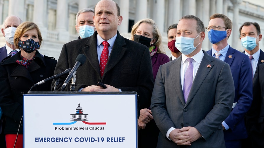 Problem Solvers Caucus co-chairs Rep. Tom Reed, R-N.Y., at podium, and Rep. Josh Gottheimer, D-N.J., right, speak to the media…