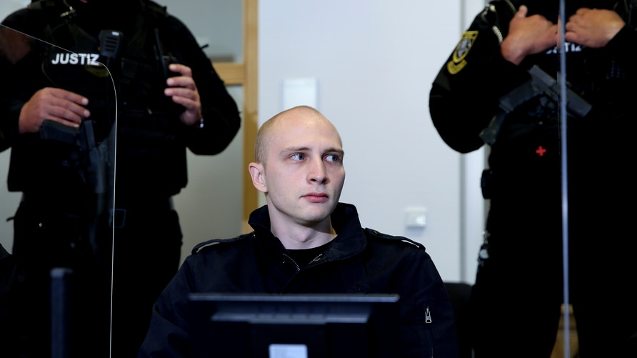 Accused Stephan Balliet sits in the regional court at the beginning of the second day of the trial in Magdeburg, Germany,…