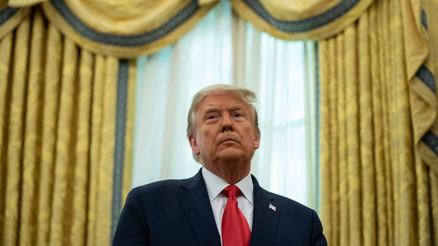 President Donald Trump listens during a ceremony to present the Presidential Medal of Freedom to former football coach Lou…