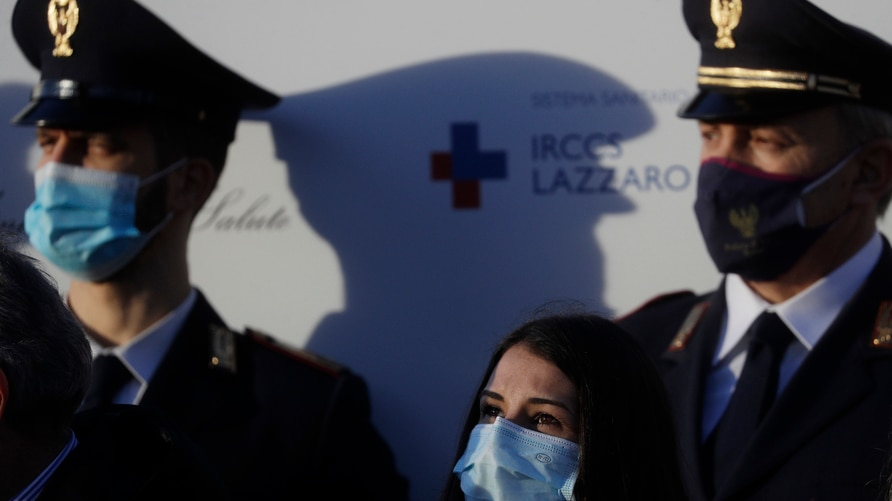 Italian Nurse Claudia Alivernini, who has been the first person in Italy to receive the Pfizer's vaccine, looks up after…