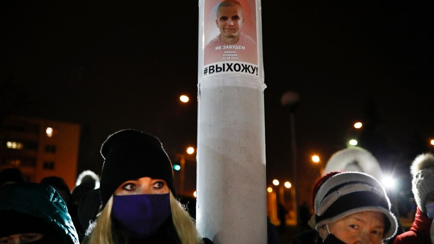 People gather to commemorate Roman Bondarenko, an anti-government protester who died in hospital following what witnesses said…