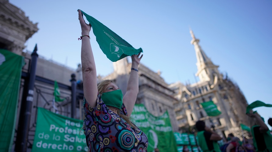 An abortion-rights activists in favor of an abortion bill currently going through Congress, holds a green bandana symbol the…
