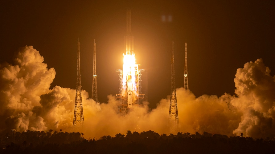 A Long March-5 rocket carrying the Chang'e 5 lunar mission lifts off at the Wenchang Space Launch Center in Wenchang in…