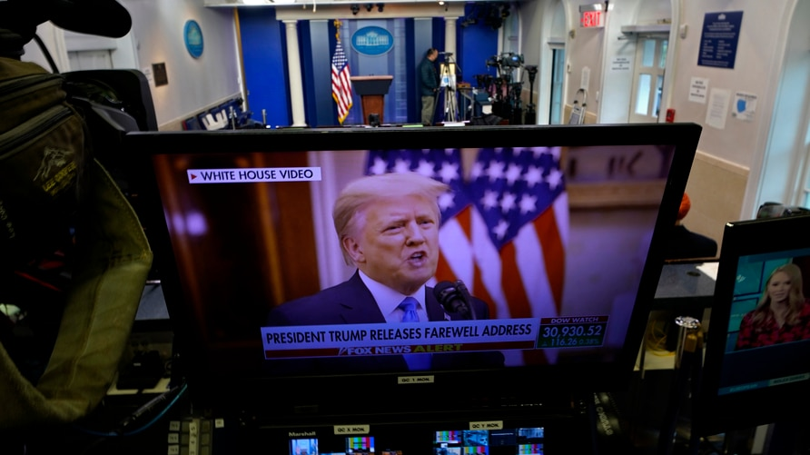President Trump is seen on a network monitor after his pre-recorded farewell speech was released, inside the Brady Press…
