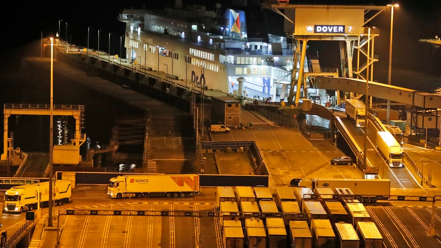 Lorries disembark the first ferry that arrived after the end of the transition period with the EU at the port in Dover, Friday,…