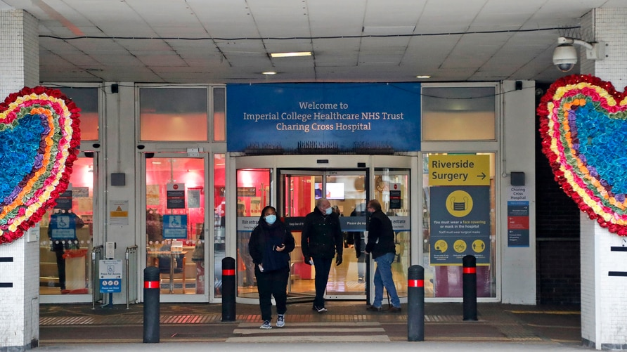People leave the Charing Cross hospital in London, Friday, Jan. 8, 2021. Britain's National Health Service will from next week…