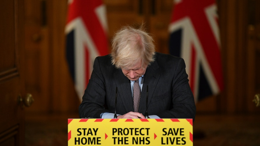 Britain's Prime Minister Boris Johnson reacts while leading a virtual press conference on the Covid-19 pandemic, inside 10…