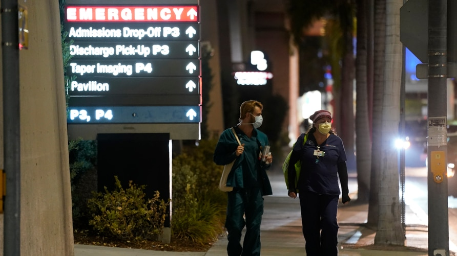 Cedars-Sinai Medical Center workers walk outside the hospital, late Tuesday, Jan. 5, 2021, in Los Angeles. Music producer and…