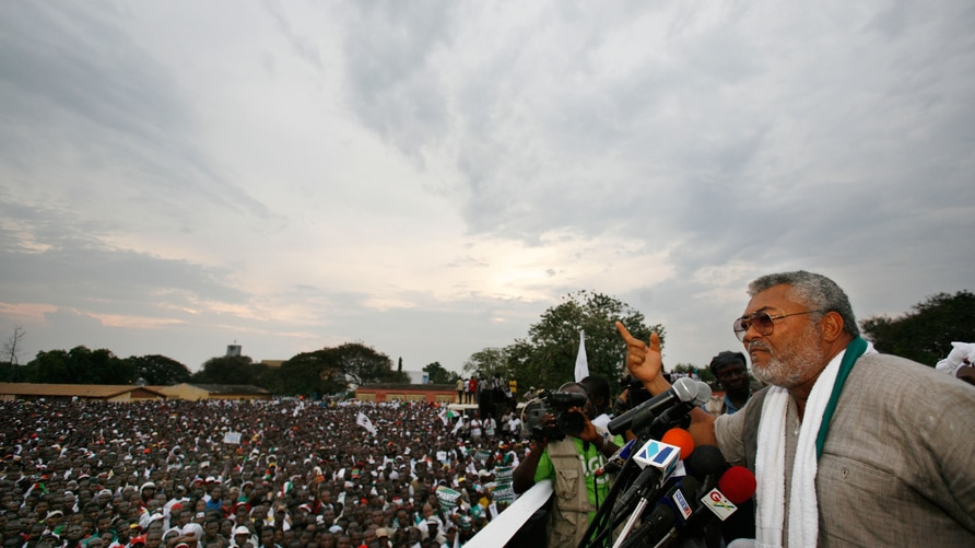 Former Ghanaian President Jerry John Rawlings speaks at the final campaign rally for opposition presidential candidate John…
