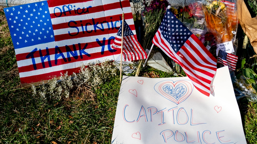 A memorial for U.S. Capitol Police officer Brian Sicknick is visible near the Capitol Building on Capitol Hill in Washington,…