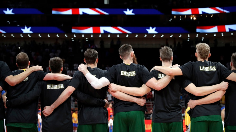 Members of Australia's team lock arms during the national anthem before their semifinal match against Spain in the FIBA…