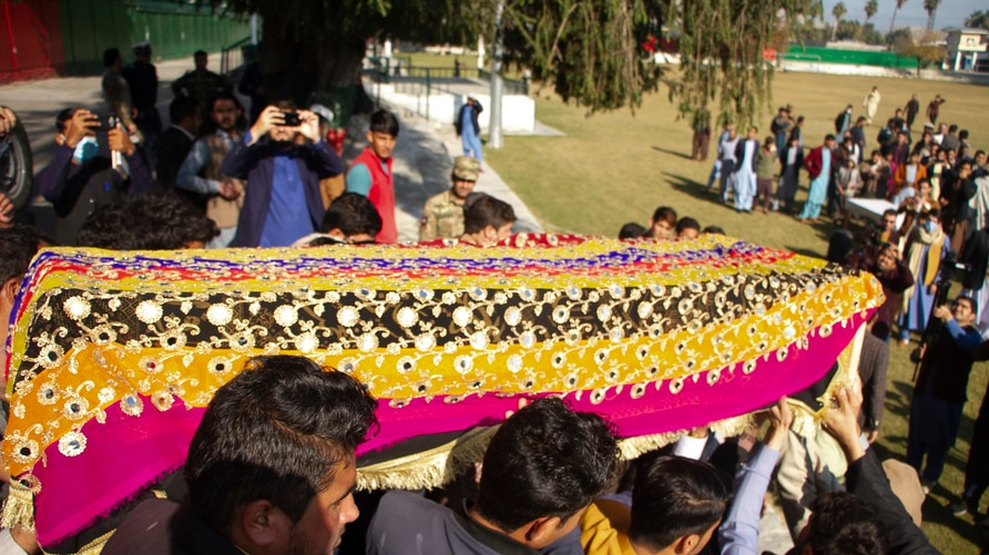Relatives carry the body of journalist Malala Maiwand who was shot and killed by gunmen soon after she left her house early…