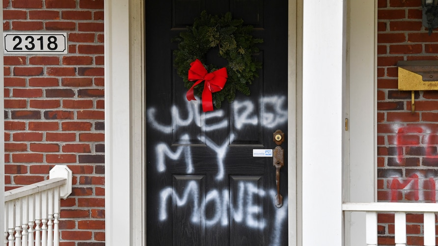 "Graffiti reading, ""Where's my money"" is seen on a door of the home of Senate Majority Leader Mitch McConnell, R-Ky., in…"