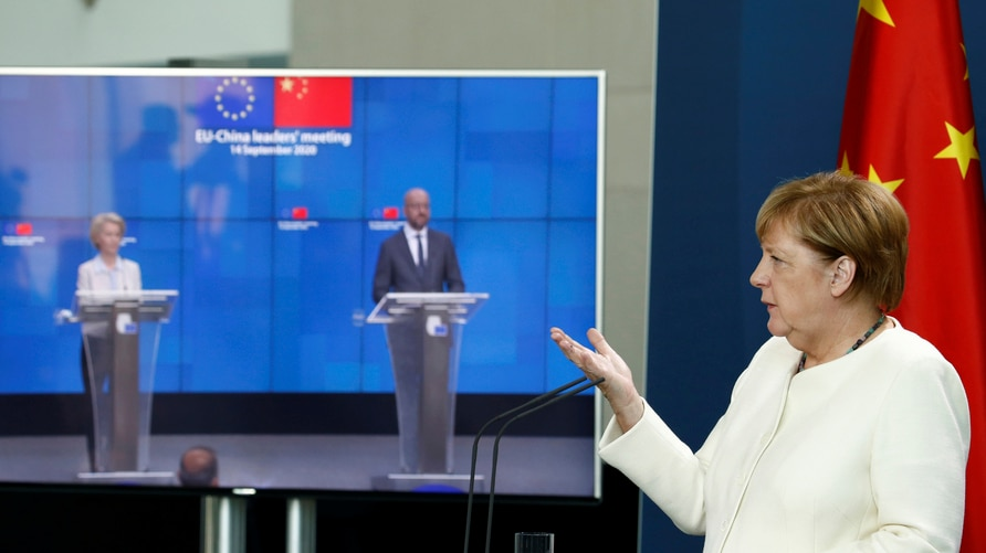 German Chancellor Angela Merkel gestures as she holds a video news conference with European Council President Charles Michel,…