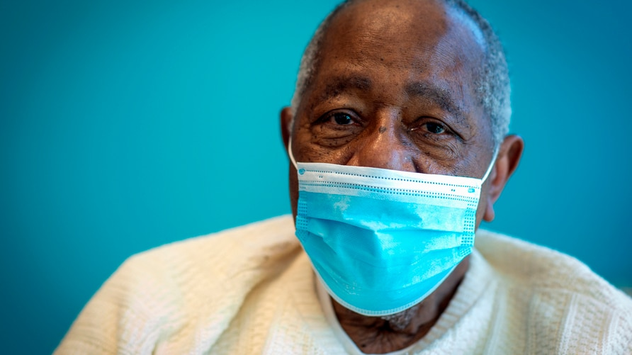 FILE - Baseball Hall of Famer Hank Aaron sits for a portrait after receiving his COVID-19 vaccination at the Morehouse School…