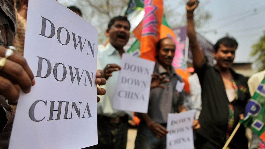 Indian activists shout slogans and hold placards during a protest in Guahati, India, Wednesday, March 21, 2012. The activists…