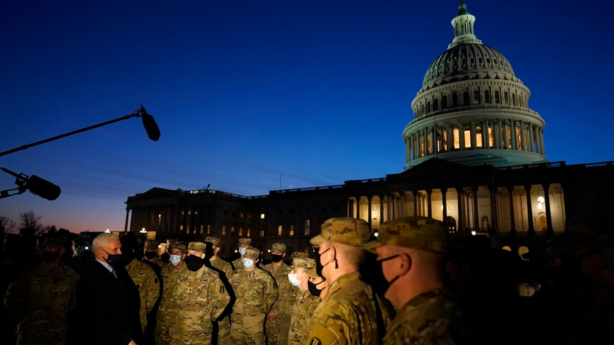 Vice President Mike Pence speaks to National Guard troops outside the U.S. Capitol, Thursday, Jan. 14, 2021, in Washington. (AP…