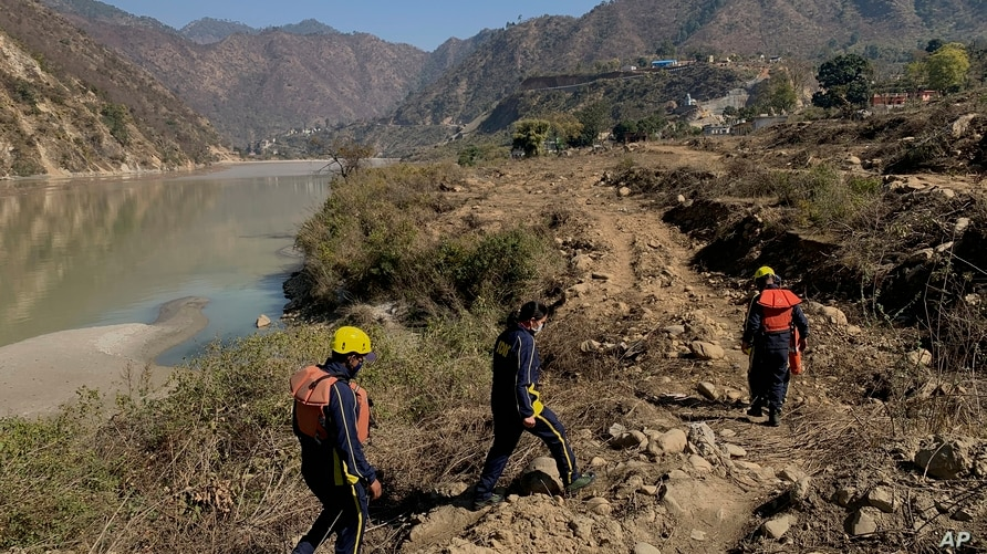 Rescuers arrive to search for bodies in the downstream of Alaknanda River in Rudraprayag, northern state of Uttarakhand, India,…