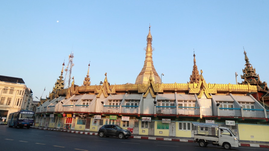 Vehicles are driven past the Sule Pagoda Monday, Feb. 1, 2021 in Yangon, Myanmar. A military coup was taking place in Myanmar…
