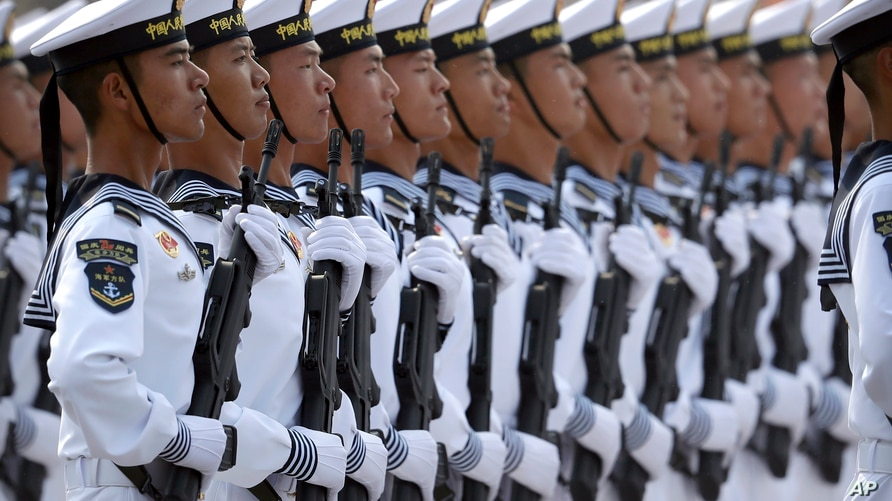 Soldiers from China's People's Liberation Army (PLA) Navy march in formation during a parade to commemorate the 70th…