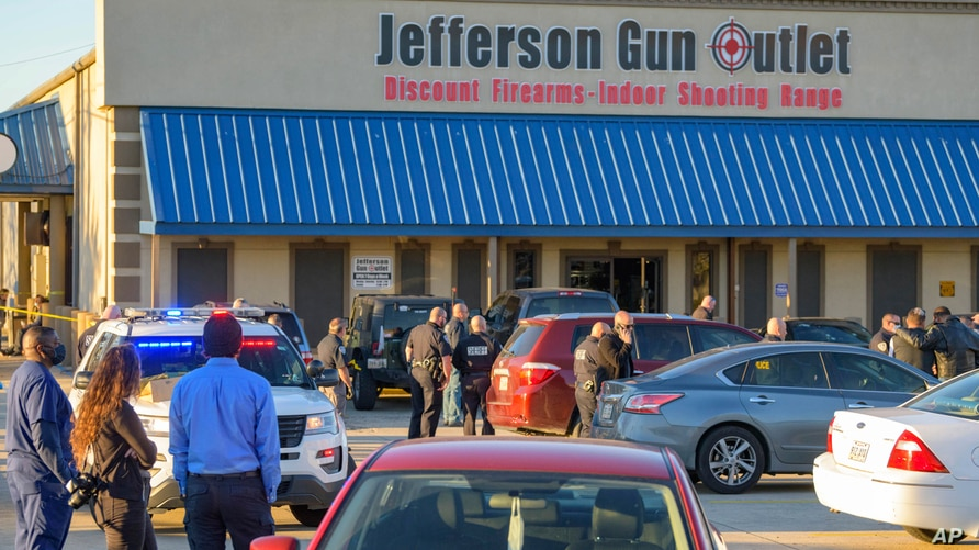 Bystanders react at the scene of a multiple fatality shooting at the Jefferson Gun Outlet in Metairie, La., Saturday, Feb. 20,…