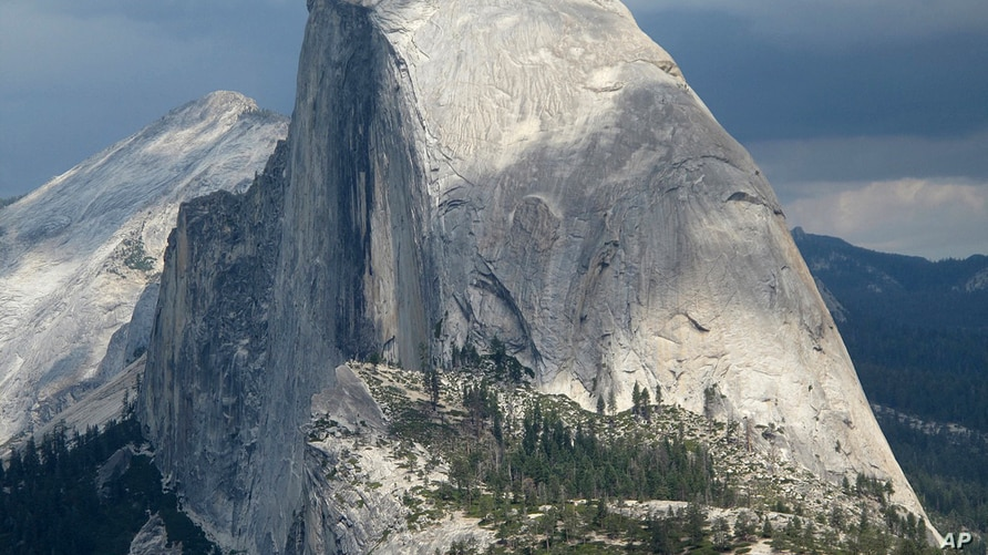 FILE - This August 2011 file photo shows Half Dome and Yosemite Valley in a view from Glacier Point at Yosemite National Park,…