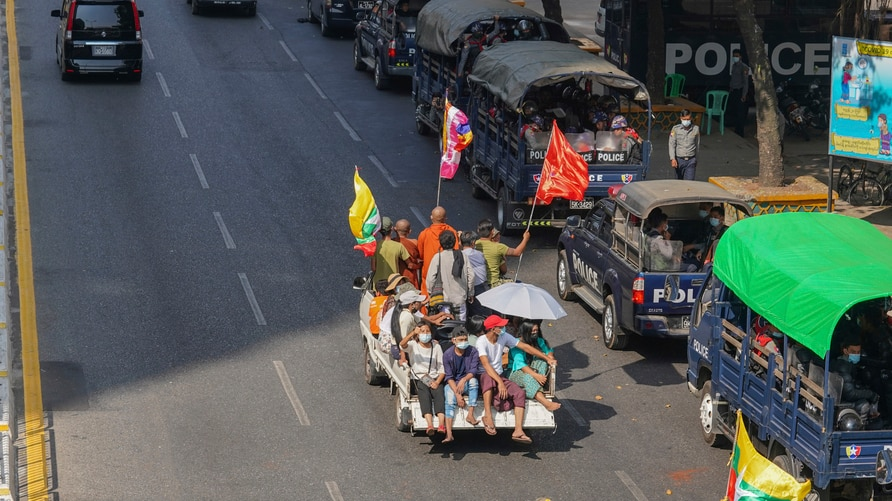A vehicle with Myanmar and military flags and supporters of the Myanmar military and the military-backed Union Solidarity and…