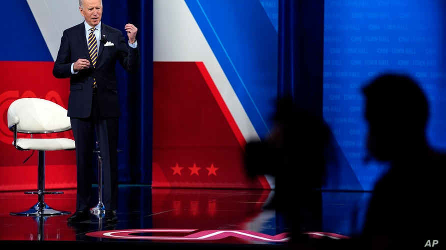 President Joe Biden talks during a televised town hall event at Pabst Theater, Tuesday, Feb. 16, 2021, in Milwaukee. (AP Photo…