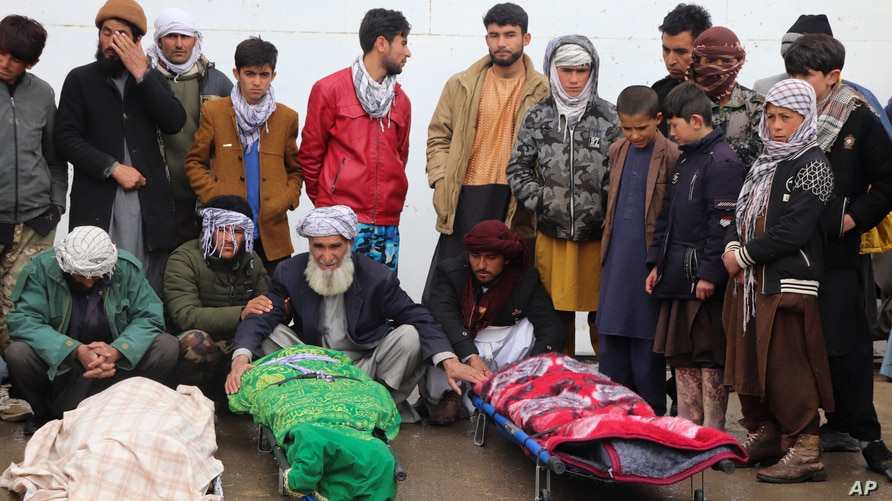 Afghans attend funeral of the family members of journalist Bismillah Adil Aimaq, who was shot dead in an unclaimed attack…