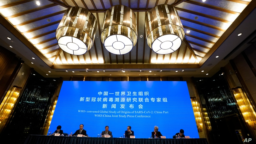FILE - In this Feb. 9, 2021, file photo, a WHO-China Joint Study Press Conference is held at the end of a WHO mission to…