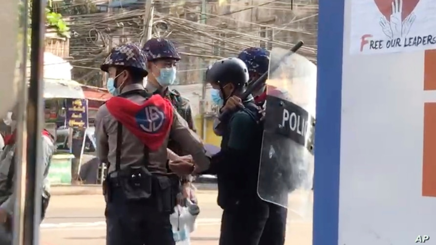 In this image made from video taken on Feb. 27, 2021, Associated Press journalist Thein Zaw is arrested by police in Yangon,…
