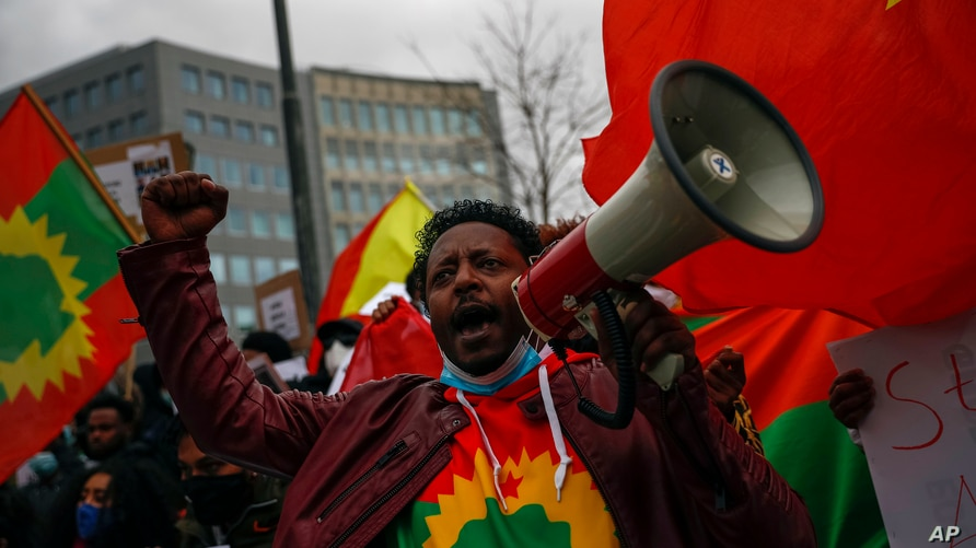 A supporter of Tigray Regional Government shout slogans against Ethiopian Prime Minister Abiy Ahmed during a protest outside EU…