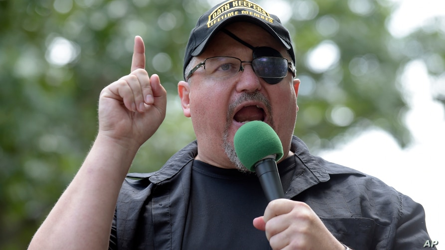 FILE - In this Sunday, June 25, 2017 file photo, Stewart Rhodes, founder of the citizen militia group known as the Oath Keepers…