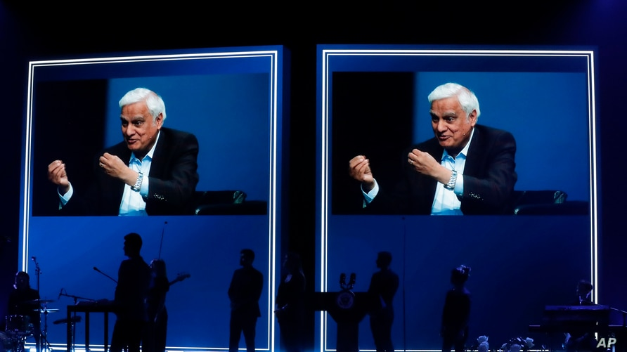 FILE - Images of Ravi Zacharias are displayed in the Passion City Church during a memorial service in Atlanta, May 29, 2020. The ministry said it will overhaul its mission after revelations its founder engaged in sexual misconduct.