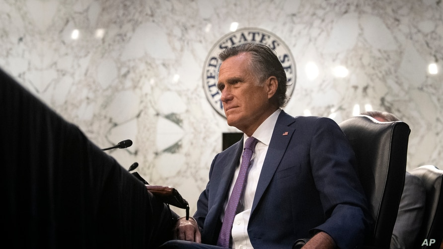 Sen. Mitt Romney, R-Utah, listens during a Senate Health, Education, Labor, and Pensions committee hearing on Capitol Hill in…