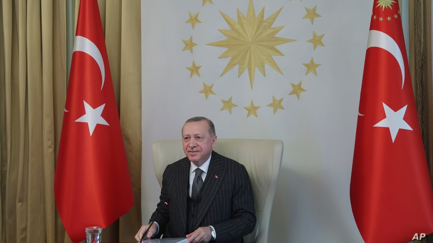Turkey's President Recep Tayyip Erdogan speaks as he participates in a video conference with European Commission President…