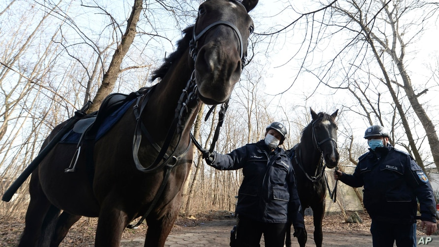Mounted police patrol in a park in Warsaw, Poland, on Friday, March 5, 2021. When they age, the dogs and horses that serve in…